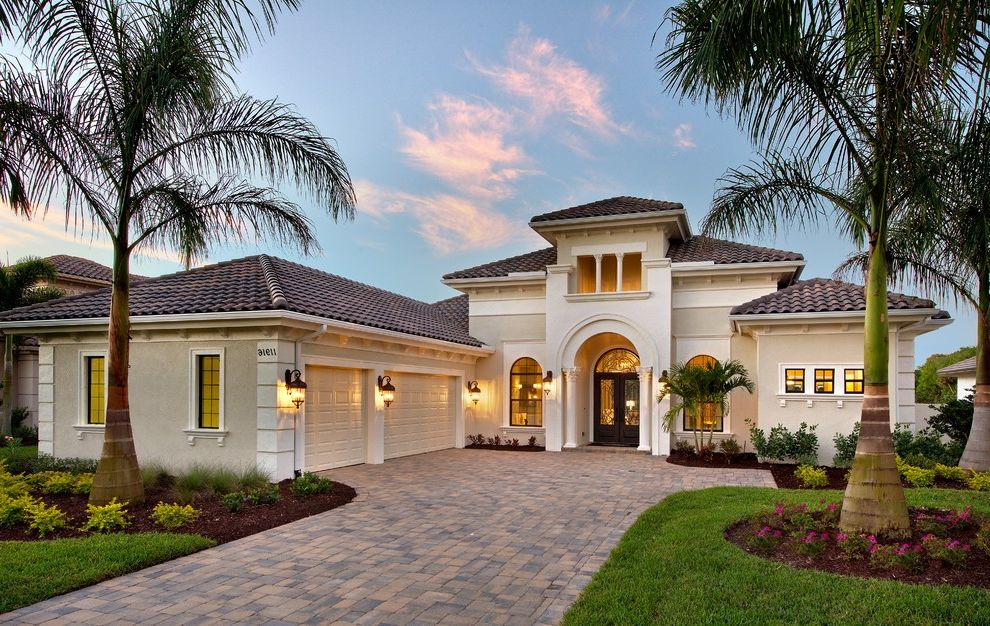 Sherwin Williams Austin   Mediterranean Exterior  and Arched Doorway Arched Windows Clay Tile Roof Concrete Pavers Driveway Landscaping Palm Trees