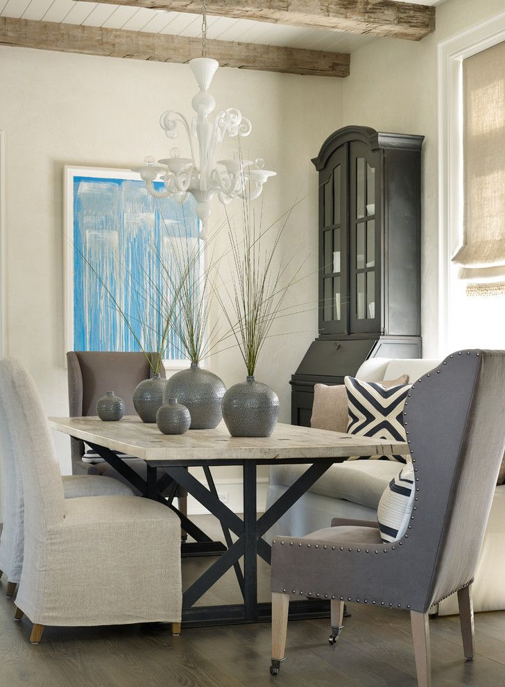Sherwin Williams Austin with Beach Style Dining Room  and Blue Abstract Art Exposed Beams Gray Vases Murano Chandelier Nailhead Detail Neutral Tones Roman Shades White Chandelier