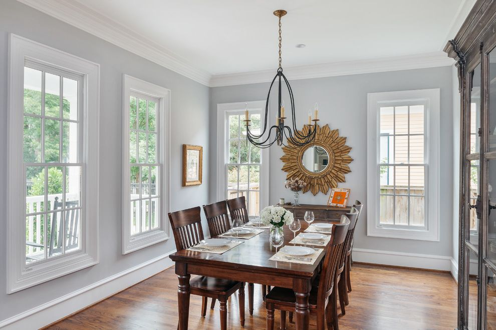 Sherwin Williams Denver with Traditional Dining Room  and Crown Molding Glass Cabinet Gold Frame Natural Lighting Sunburst Mirror