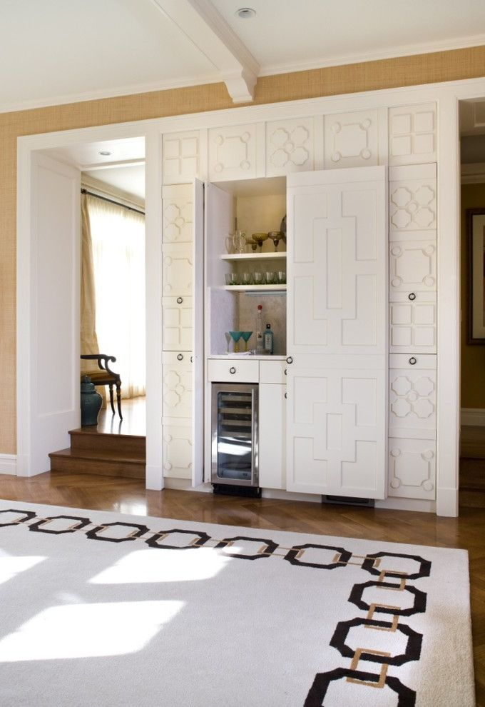 Small Wine Fridge   Contemporary Home Bar  and Carved Wood Cabinets Crown Molding Geometric Patterns Herringbone Wood Floor Pull Out Doors Steps White Painted Beams White Trim