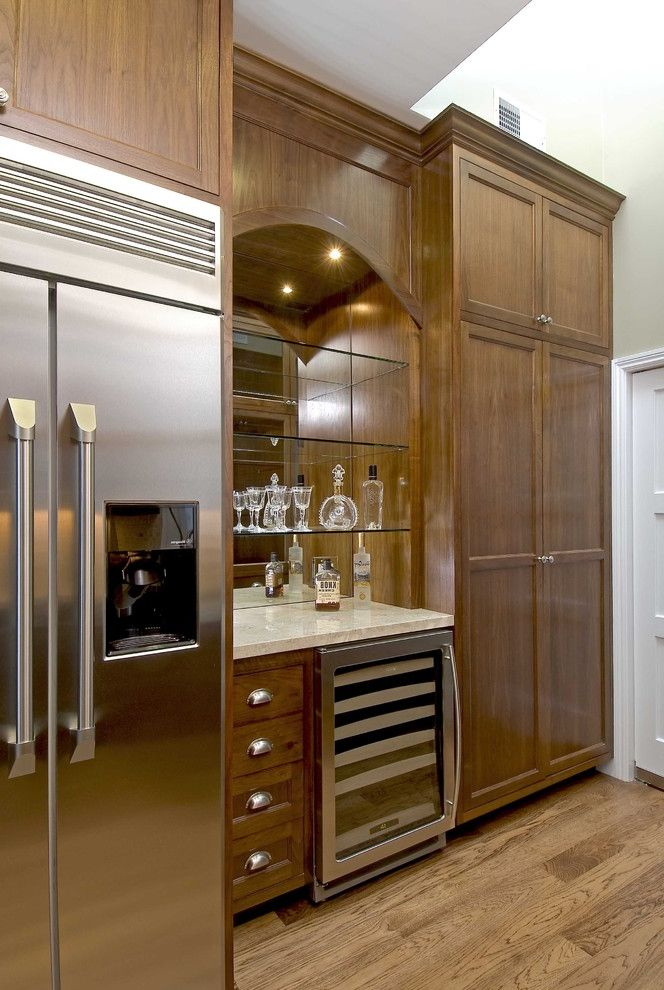 Small Wine Fridge with Traditional Kitchen  and Beverage Cooler Drawer Pull Frame and Panel Glass Shelves Mirrored Shelves Stainless Steel Appliances White Painted Trim Wood Cabinets Wood Floor