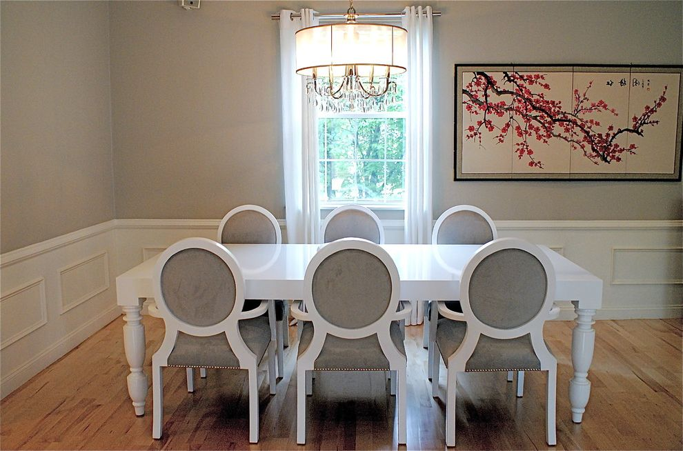 Snows Furniture with Contemporary Dining Room Also Curtains Dining Room Drapes Louis Chiar Neutral Colors Shade Chandelier Upholstered Dining Chairs Wainscoting Wall Art Wall Decor White Window Treatments Wood Flooring