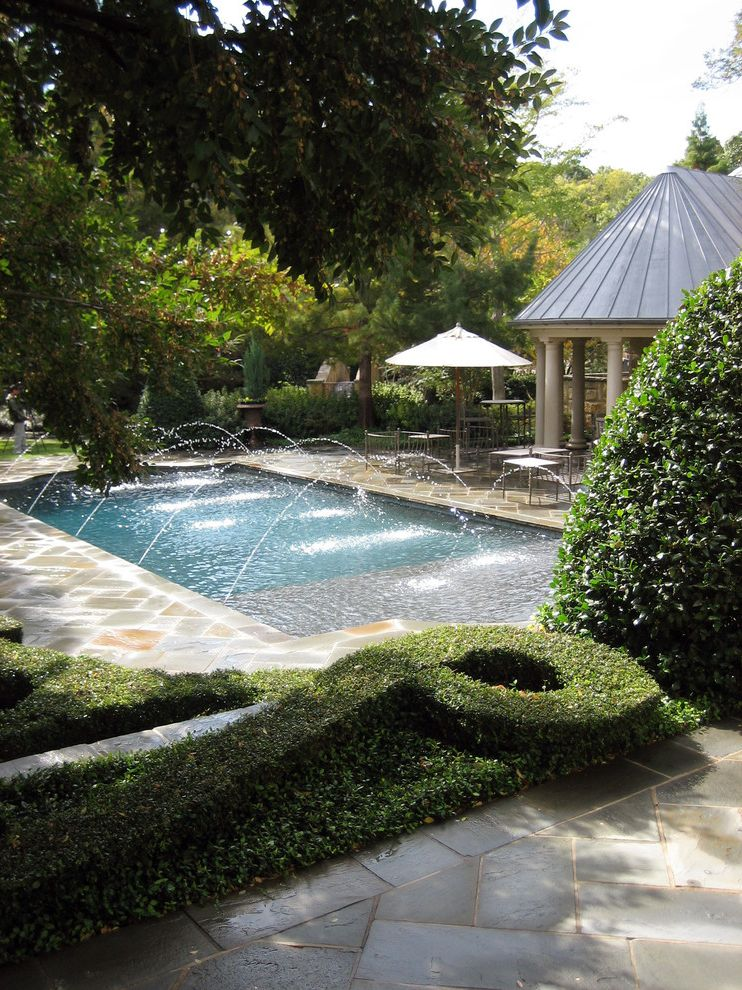 Spray Tan Cost   Traditional Pool  and Boxwood Cabana Columns Formal Gardens Hedges Landscape Metal Roof Outdoor Dining Outdoor Furniture Outdoor Potted Plant Outdoor Umbrella Pillars Pool Pool Fountain Pool Water Feature Shrubs Stone Patio Trees