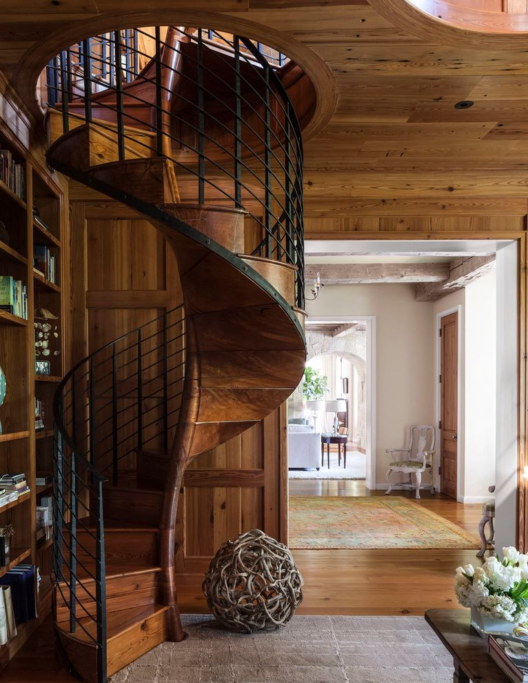 Staircase in the Woods with Transitional Staircase  and Built in Bookcase Driftwood Ball Gray Area Rug Metal Railing Wood Ceiling Wood Wall Paneling