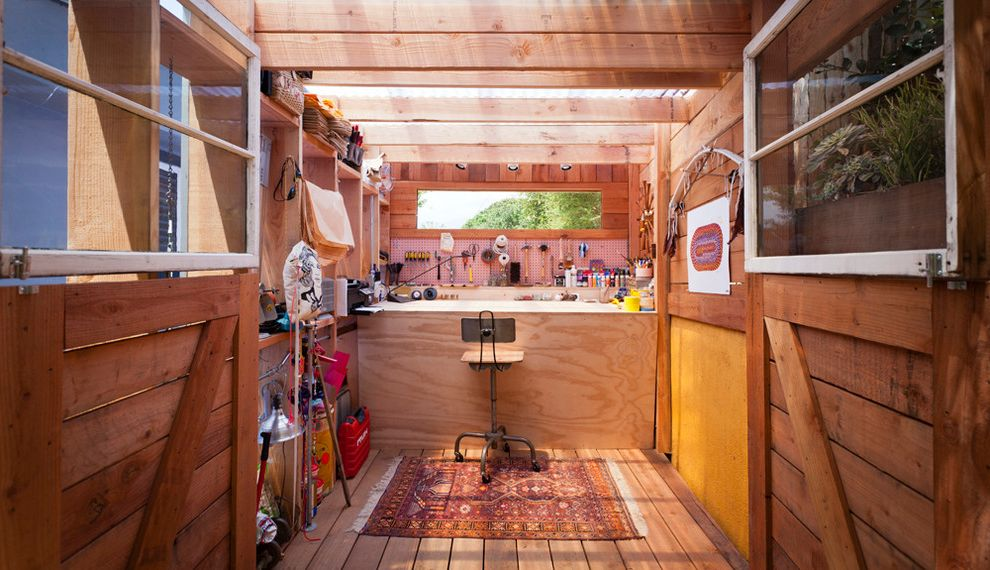 Stardust Building Supplies   Contemporary Shed  and Industrial Barstool Tool Shed Wood Floor Workspace Yellow Wall