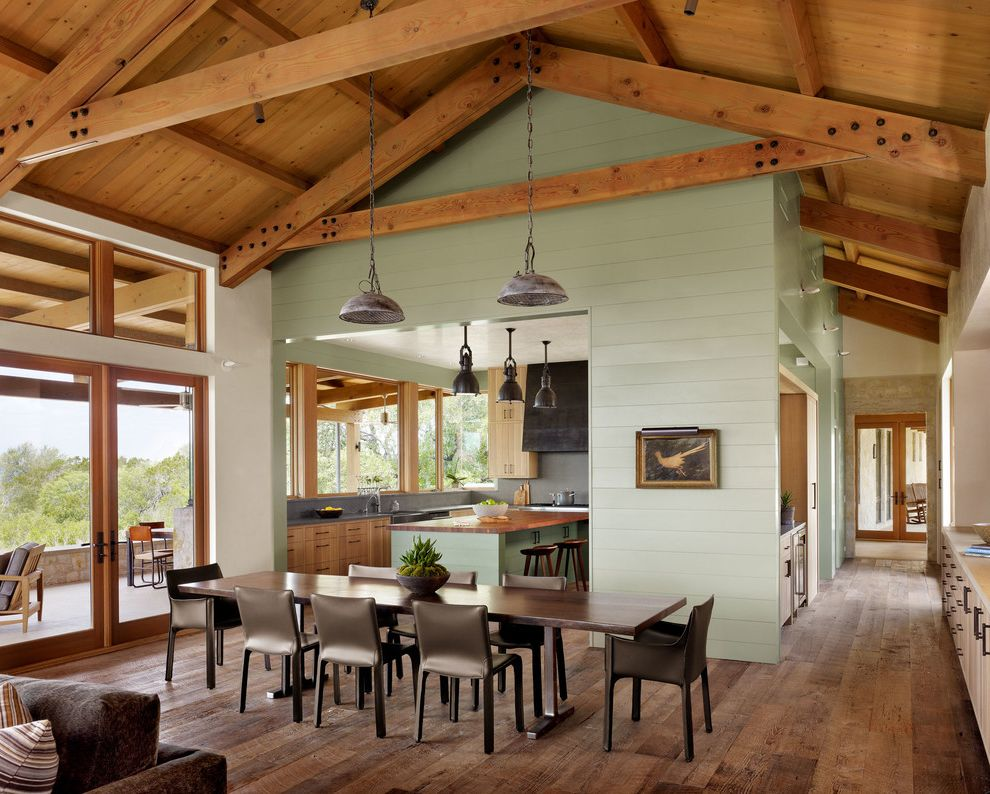 Stardust Building Supplies   Farmhouse Dining Room  and Brown Dining Chairs Exposed Beams and Trusses Green Walls Long Dark Wood Dining Table Pendant Light Vaulted Ceilings