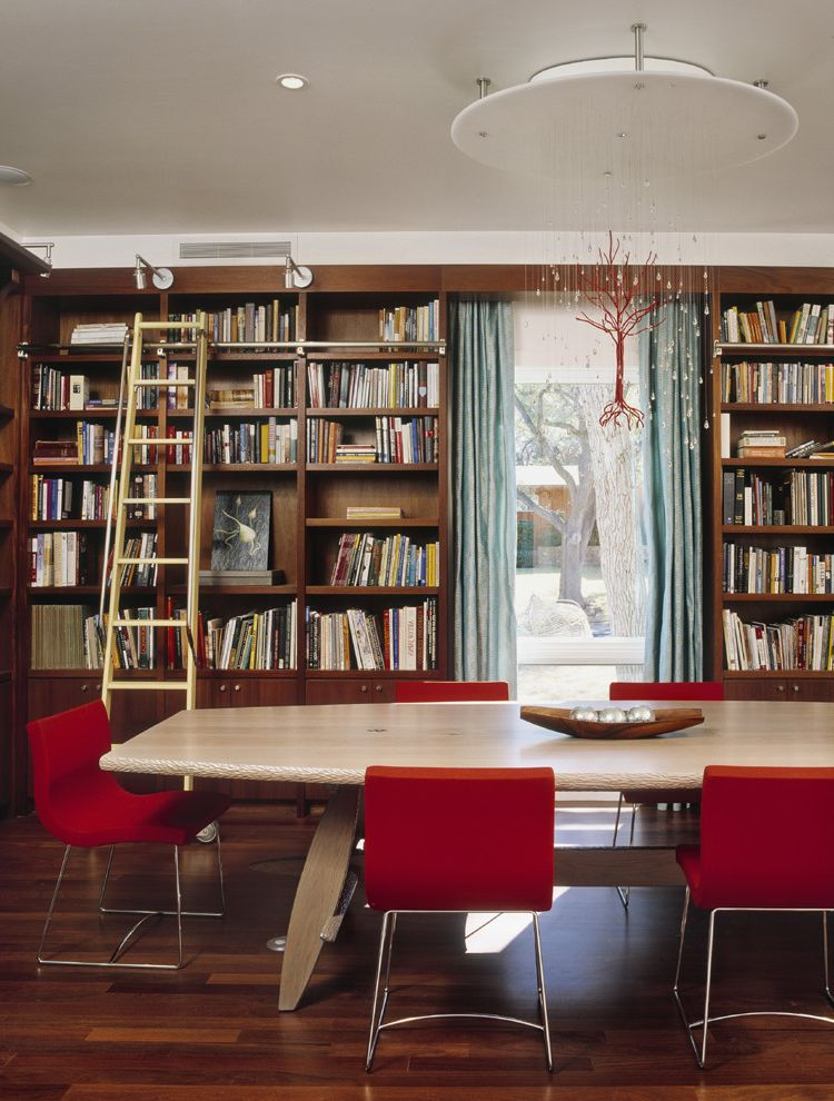 T Mobile Corporate Office   Contemporary Dining Room Also Bookcase Bookshelves Built in Shelves Canopy Chandelier Chandelier Curtains Dark Floor Drapes Library Library Ladder Red Dining Chairs Rolling Ladder Window Treatments Wood Flooring