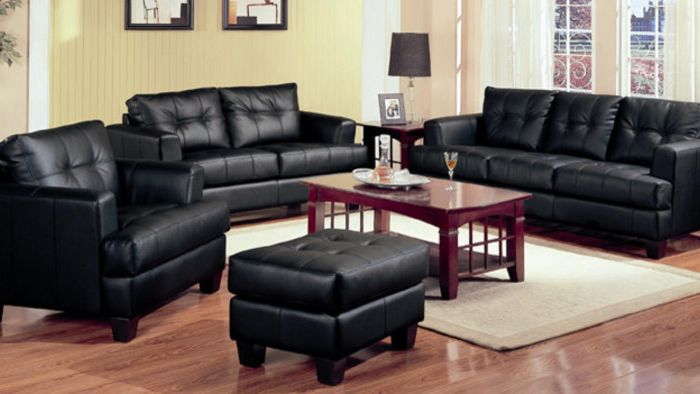 T&d Furniture    Living Room  and Black Leather Chair Black Leather Sofa Wood Coffee Table Wood Flooring Yellow Walls