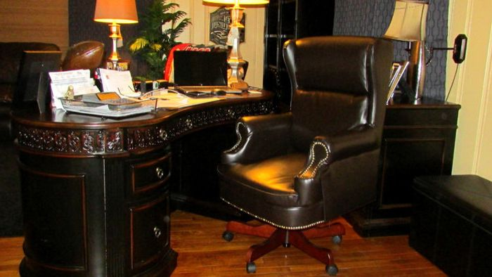 T&d Furniture    Spaces  and Black Leather Chair Dark Wood Desk Leather Chair Medium Wood Floors Wood Flooring Yellow Walls