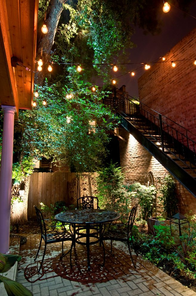 The Ordinary Charleston with Traditional Patio  and Brick Column Exterior Lighting Fence Hardscape Landscape Landscape Lighting Led Lighting Outdoor Furniture Patio Lighting Pavers Staircase String Lights