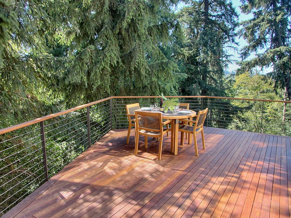 Trex Decking Cost   Contemporary Deck Also Cantilever Deck Handrail Neutral Colors Outdoor Dining Patio Furniture Round Dining Table Steel Cable Railing Table Setting View Wood Flooring