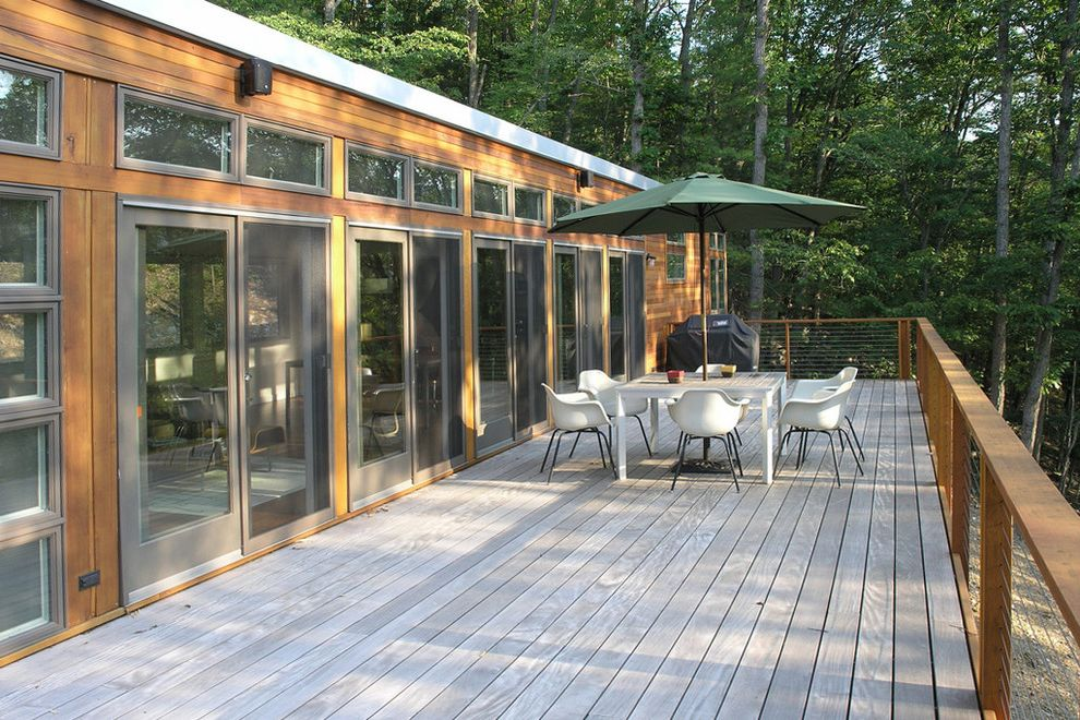 Trex Decking Cost   Modern Deck  and Cabin Cable Railing Deck Hillside Modern Icons Patio Furniture Patio Umbrella Sliding Doors Slope Wood Siding