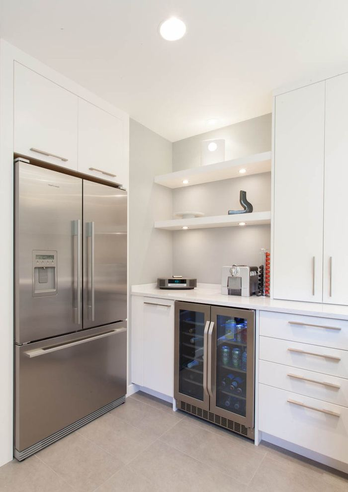 Under Counter Wine Fridge with Contemporary Kitchen Also Beverage Cooler Floating Shelves Flush Cabinets Gray Tile Floor Stainless Steel Appliances Under Cabinet Lights White Cabinets White Counters