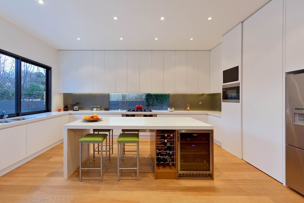 Under Counter Wine Fridge with Contemporary Kitchen  and Black Window Frame Green Bar Stool Recessed Lighting Under Counter Refrigerator Waterfall Countertop White Countertop Wine Refrigerator