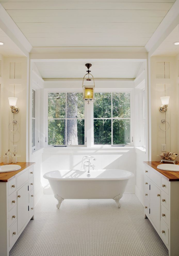 Used Clawfoot Tub   Rustic Bathroom  and Bay Window Clawfoot Tub Country Dual Vanities Heart Pine Countertops Lantern Pendant Light Penny Tile Soaking Tub Traditional Architecture Vintage Lighting Wall Sconces White Vanities Windows Wood Counters