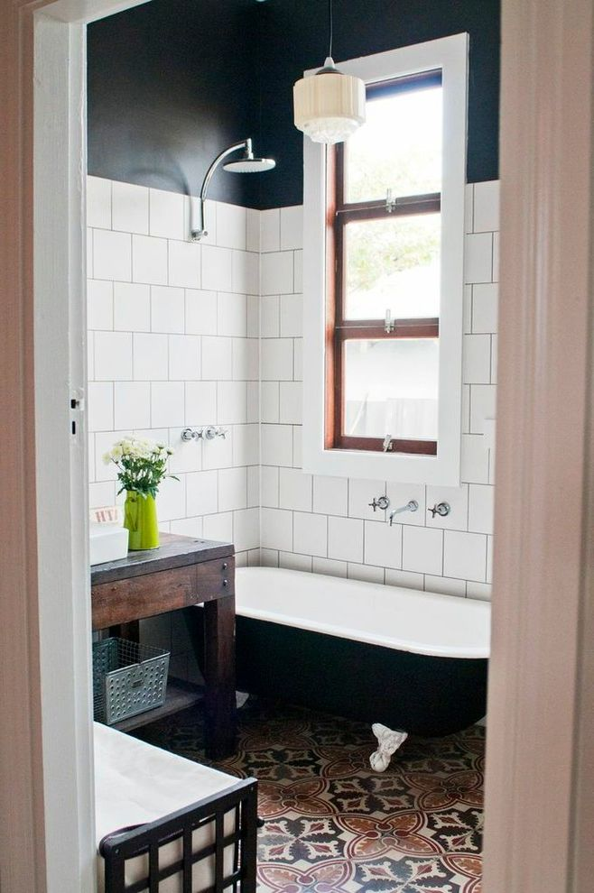 Used Clawfoot Tub   Victorian Bathroom  and Black Claw Foot Tub Black Wall Claw Foot Tub Encaustic Tiles Mediterranean Tile Floor Pendant Light Rustic Wood Vanity White Tile Wall