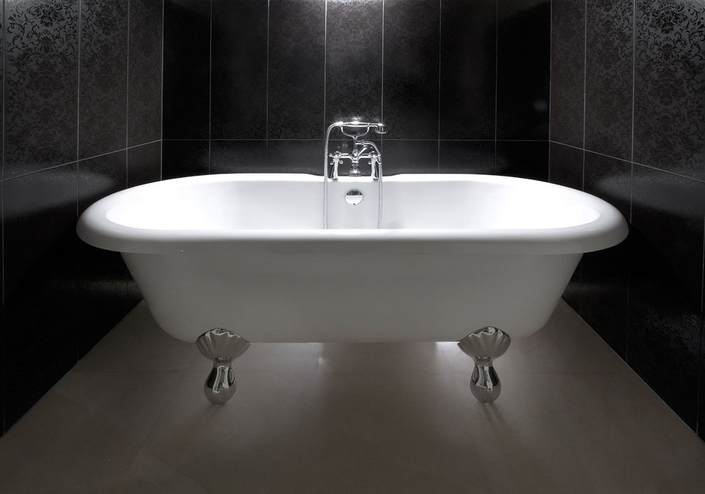 Used Clawfoot Tub with Contemporary Bathroom  and Alcove Bath Fixtures Clawfoot Tub Freestanding Bathtub Grey Wall Nook Stone Flooring Stone Wall Tile Wall