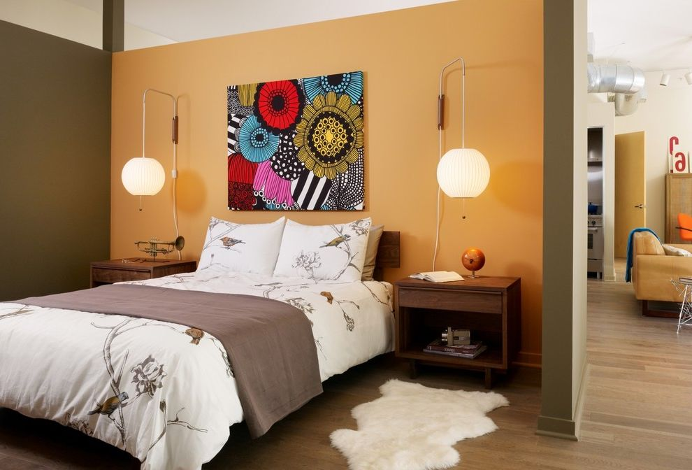 Vista Print Coupon Code   Modern Bedroom  and Accent Walls Artwork Bubble Lamps Chinoiserie Bedding Exposed Duct Fur Rug Open Floor Plan Orange Wall Partial Wall Support Post Table Lamps Wood Flooring Wood Headboard Wood Nightstands