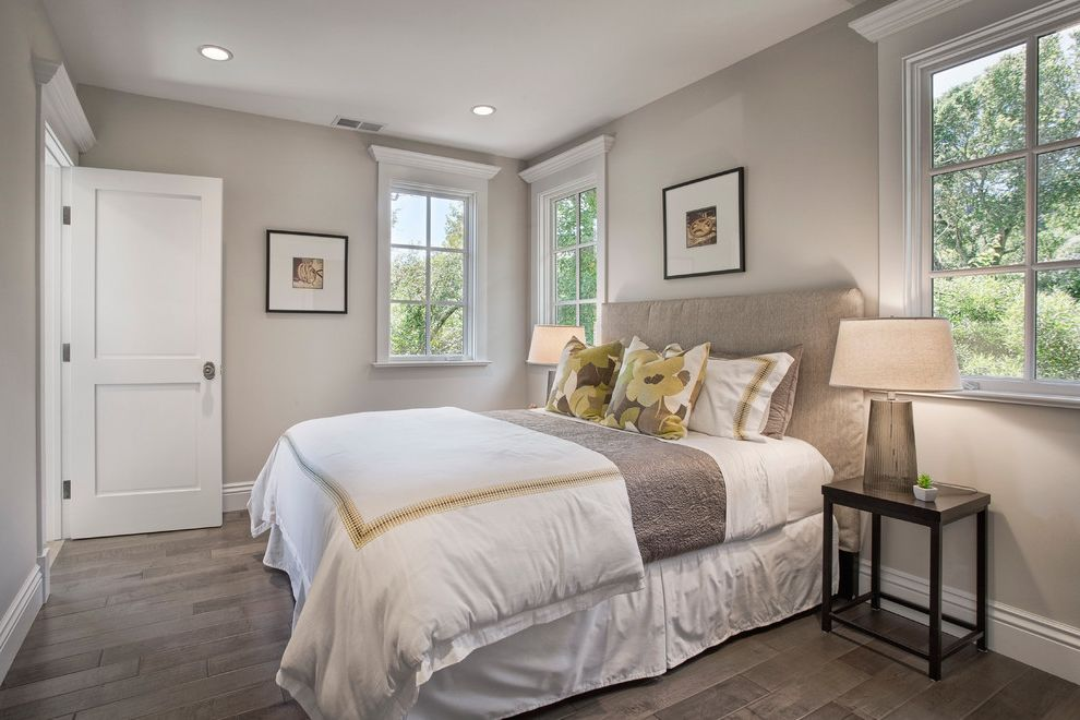 Whats a Duvet   Traditional Bedroom  and Beige Bed Beige Bedding Beige Headboard Beige Table Lamp Beige Wall Black Frames White Baseboard White Bedding White Door White Molding White Sham White Window Trim Wood Floor