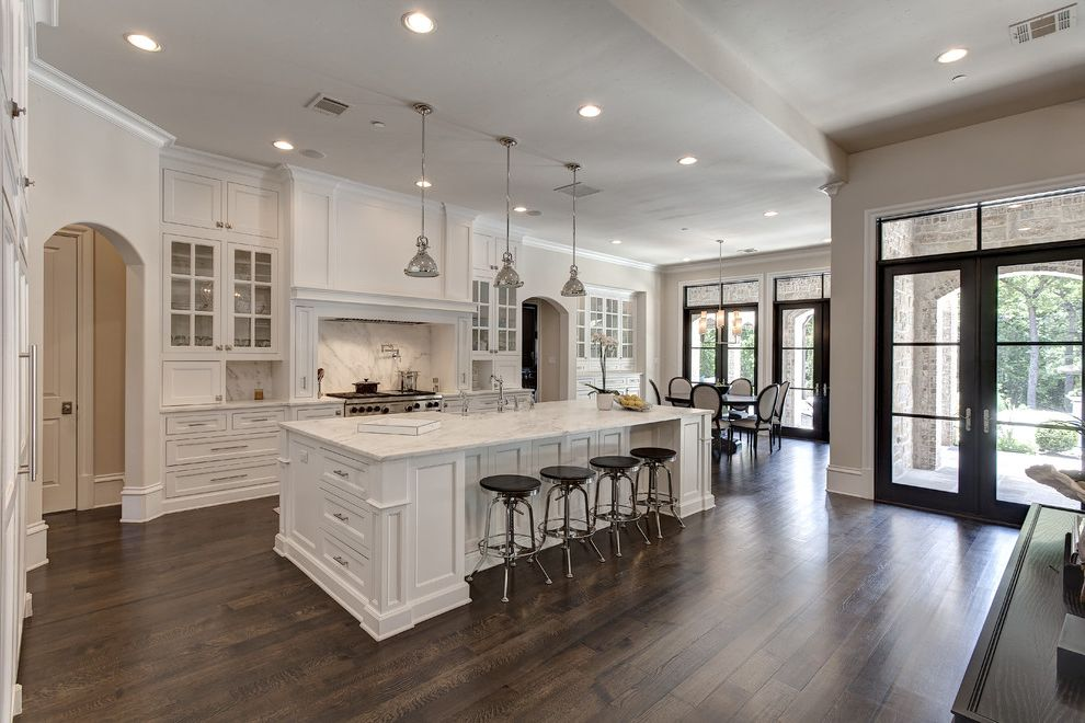 Whats a Duvet   Traditional Kitchen  and Arched Doorway Black Bar Stools Pendant Lights Recessed Lighting White Countertop
