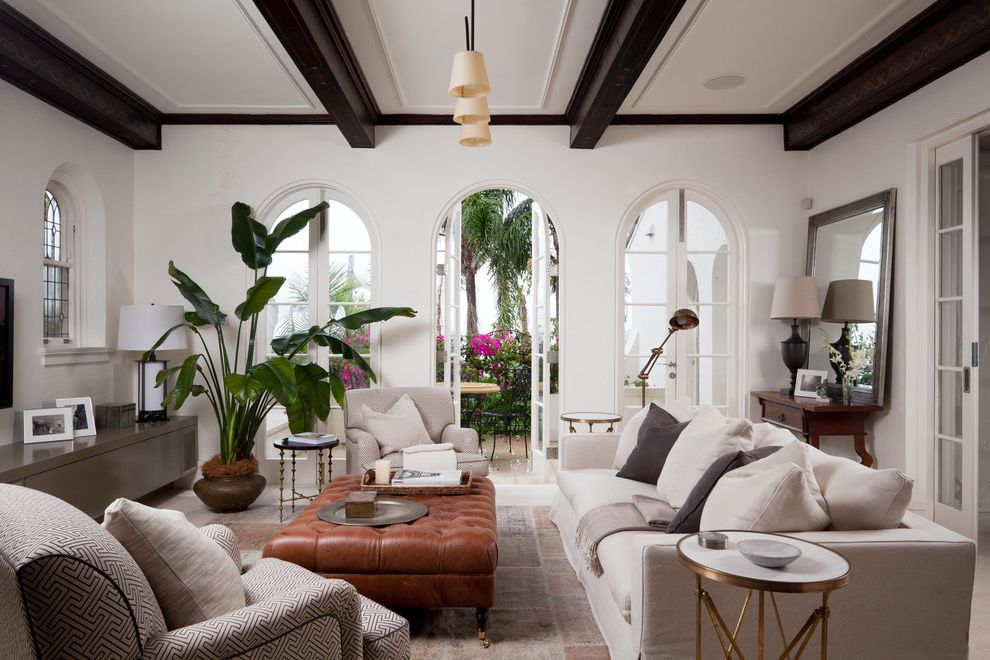 When to Plant Sunflowers   Mediterranean Living Room  and Arched Doors Box Beams French Doors Indoor Plants Joinery Living Room Tufted Ottoman