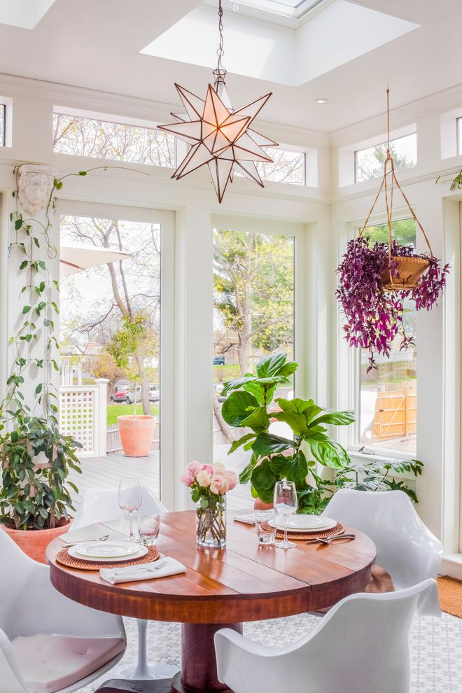 When to Plant Sunflowers with Transitional Sunroom  and Bohemian Boho Conservatory Greenhouse Indoor Plants Round Wood Table Solarium Star Pendant Tulip Chairs