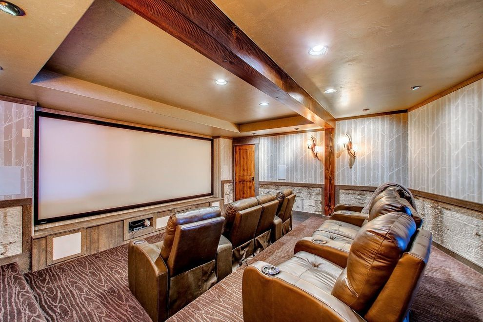 Whitewater Theater with Rustic Home Theater  and Beams Leather Armchair Movie Room Screening Room Theater Seating Tiered Wall Sconces Wallpaper