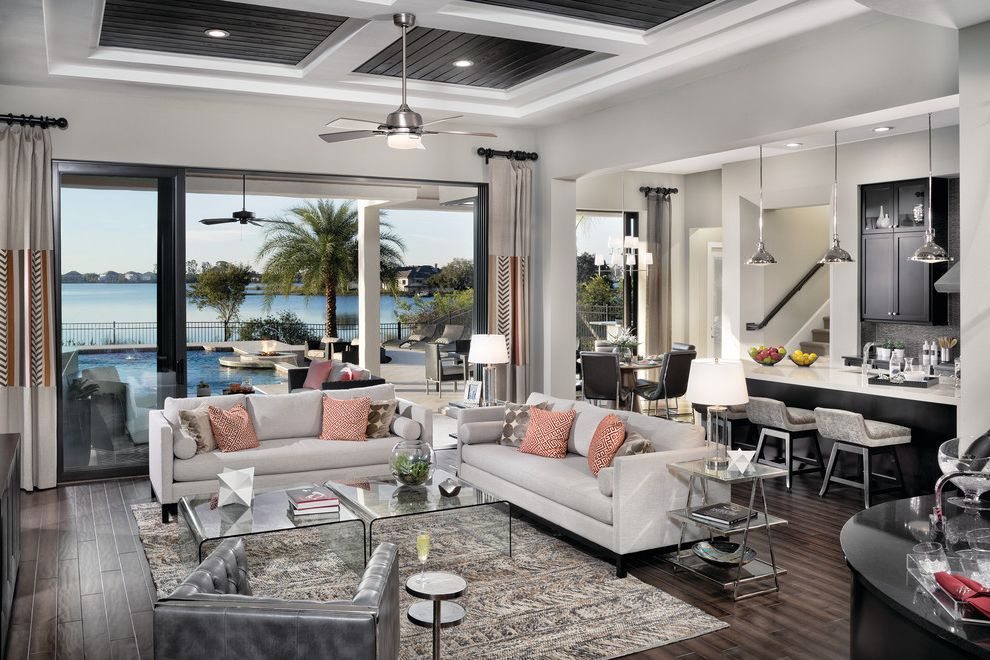 Woodmore Town Center   Contemporary Living Room Also Black Chai Coral Pillows Floor to Ceiling Windows Glass Coffee Table Gray Area Rug Gray Couch Gray Stools Great Room Lake View Modern Living Room Open Concept Silver Accent Table Silver Ceiling Fan