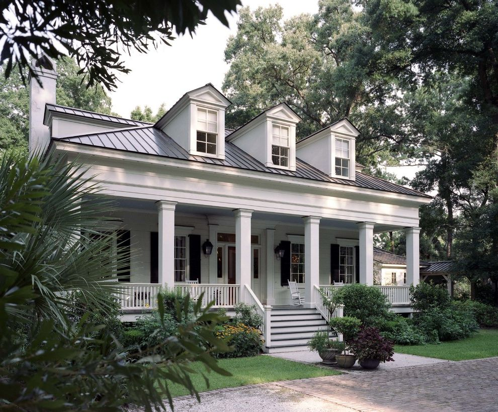 Woodmore Town Center   Traditional Exterior  and Black Shutters Box Columns Brick Patio Columns Dormers Front Porch Gas Lanterns Greek Revival Lap Siding Metal Roof Porch Rocking Chairs Transom Window White and Black Wood Railing