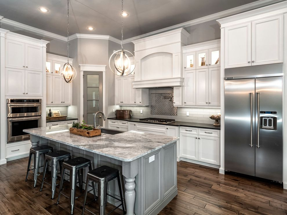 Woodmore Town Center   Traditional Kitchen Also Dark Hardwood Farmhouse Sink Gray and White Kitchen Gray Island Industrial Barstool Pantry Dor Pendant Lights