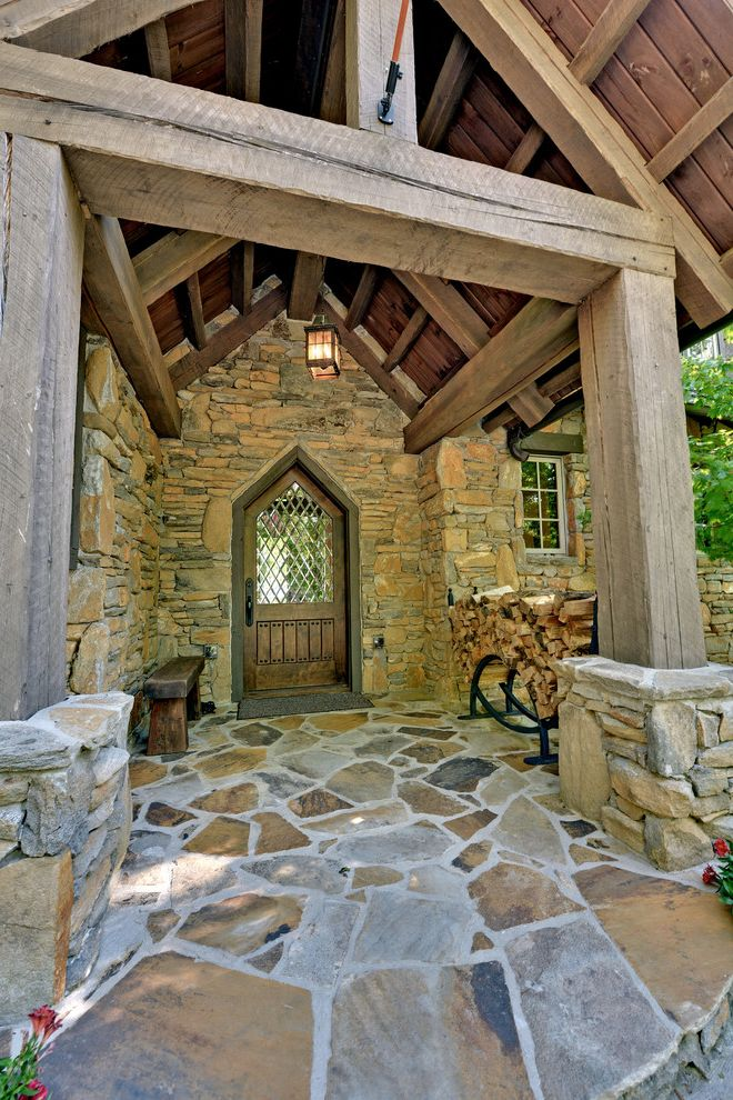 Woodmore Town Center with Rustic Entry Also Bench Seat Beveled Glass Covered Entry Firewood Storage Flagstone Gable Roof Lantern Leaded Glass Lintel Lodge Rustic Stacked Stone Stone Veneer Timberframe Wood Beams