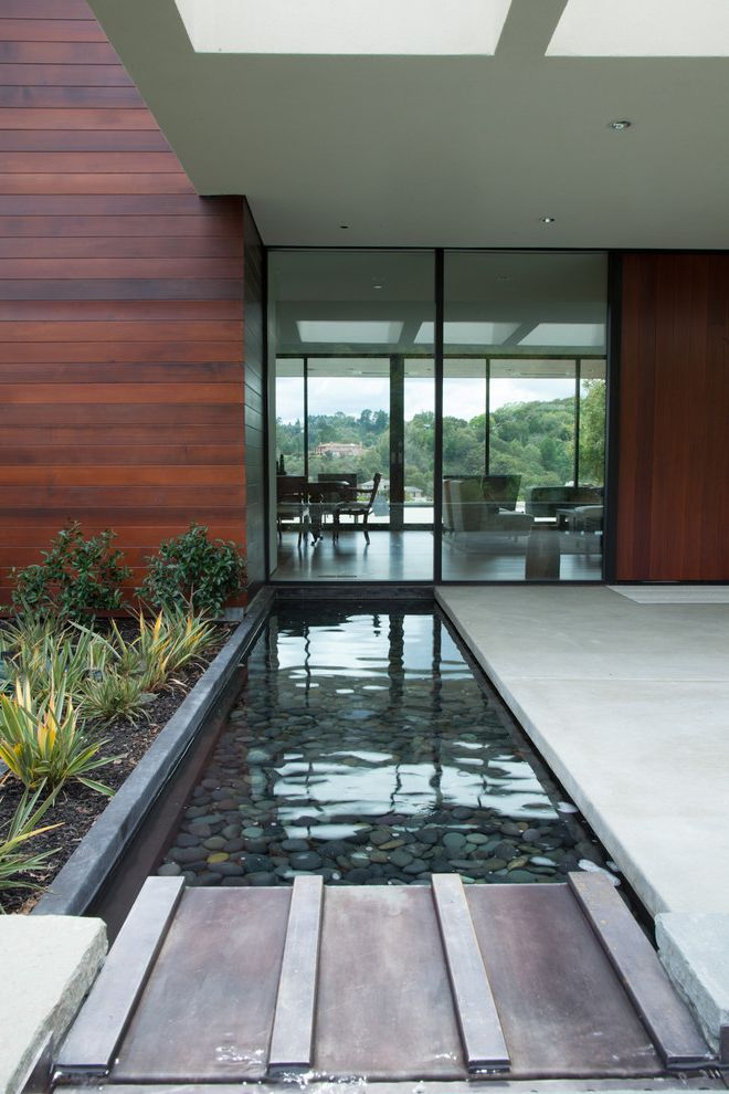 Woods and Water Realty   Modern Landscape  and Glass Door Pebbles Steel Stone Water Feature Wood Siding