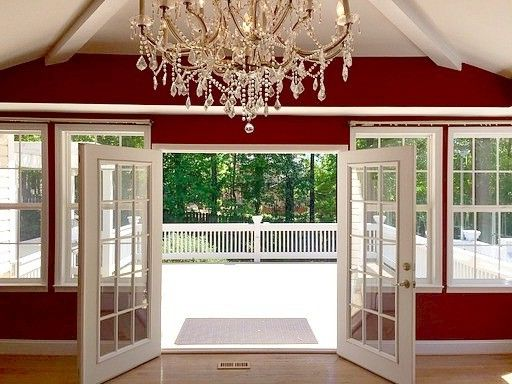 Alabama Rental Managers    Spaces  and Chandalier French Doors Natural Light Red Dining Room Wall