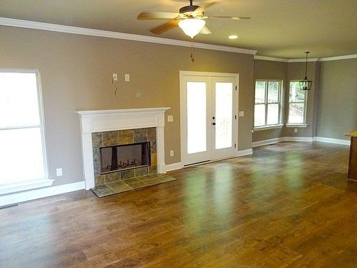 Alabama Rental Managers   Traditional Living Room  and Fireplace Hardwoods Living Room