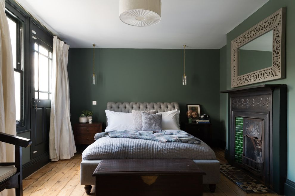 Alabama Rental Managers   Transitional Bedroom Also Elegance Fireplace Green Quilted Duvet Quilted Headboard Rich Colours Wooden Floor