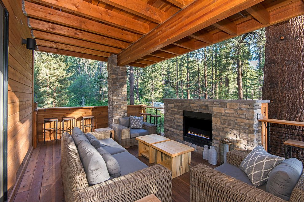 Alabama Rental Managers with Rustic Deck  and Cedar Siding Chiseled Edge Outdoor Furniture Ski Lodge Stone Columns Stone Wall Vacation Rental Wicker Furniture