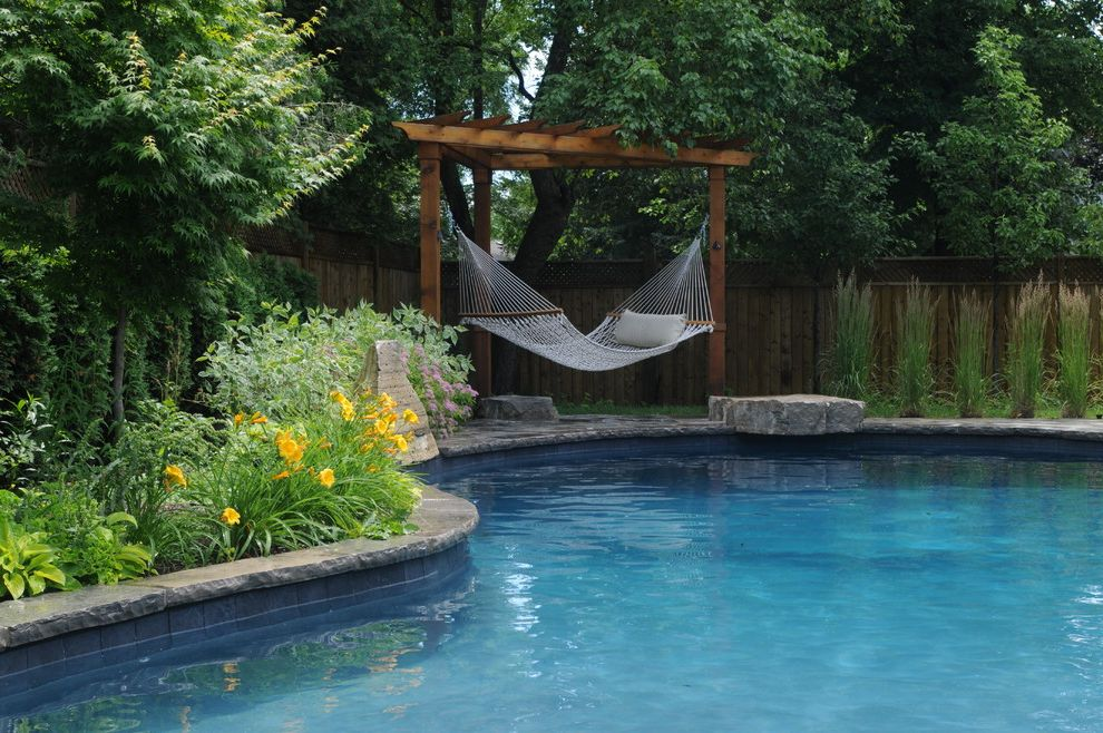 Hammocks with Stands with Traditional Pool Also Day Lilies Design a Pool Toronto Hammock Outdoor Living Space Pergola Pool Contractors Toronto Stone Pool Surround Swimming Pool Swimming Pool Design Toronto Trellis Yellow Flowers