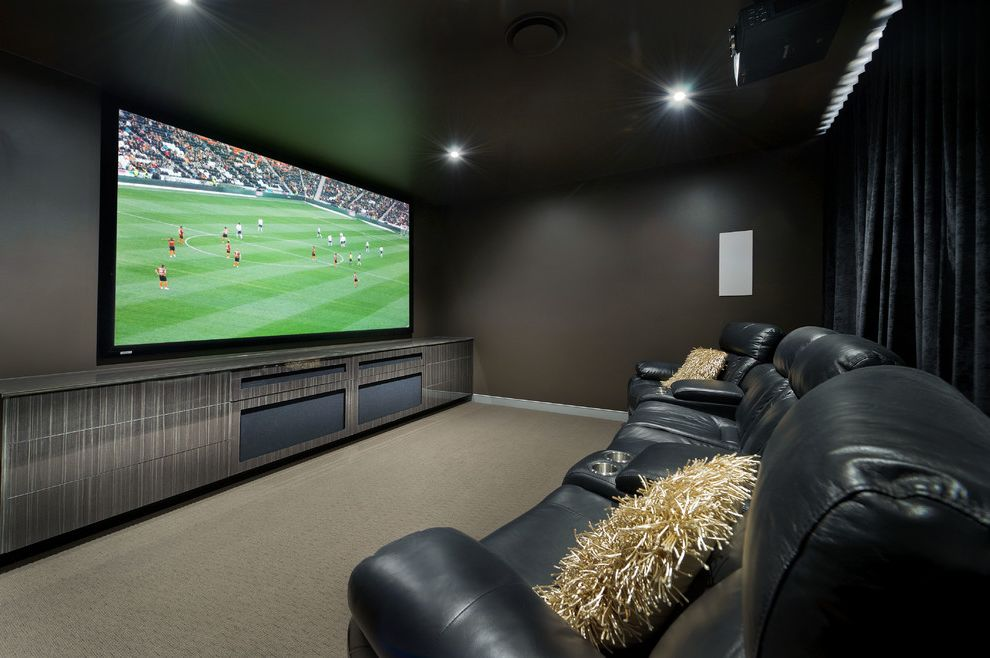 Hitching Post Theater   Contemporary Home Theater  and Beige Carpet Big Screen Black Leather Chairs Black Recliners Colour and Finishes Selection Home Theater Movie Projector Movie Room Tan Carpet Velvet Curains