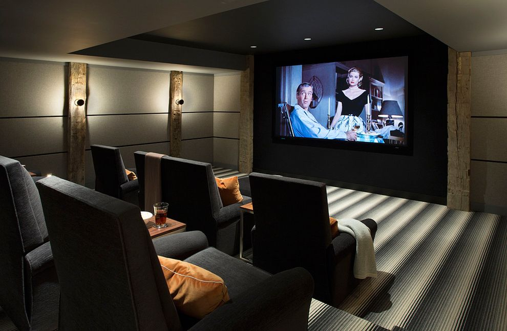 Hitching Post Theater with Farmhouse Home Theater Also Accent Lighting Gray Theater Seating Home Theater Room Indoor Entertaining Recessed Lighting Rough Hewn Wood Accents Striped Rug Theater Theater Room Theater Seating Tv Room