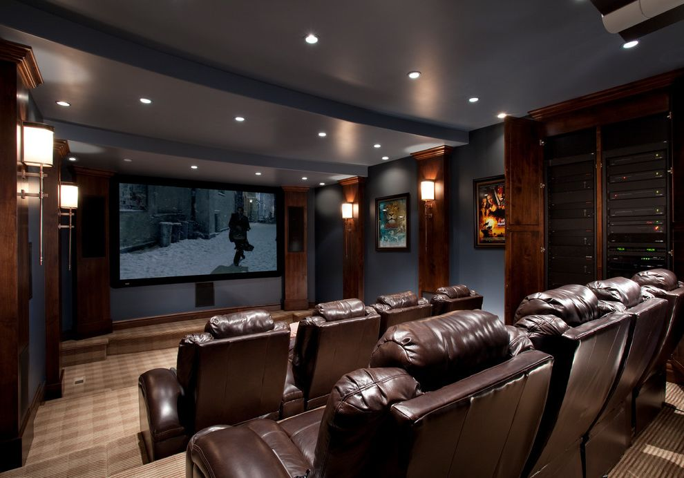 Hitching Post Theater with Traditional Home Theater Also Blue Beams Blue Walls Brown Chairs Home Theater Media Equipment Movie Posters Movie Theater Plaid Carpet Recessed Lighting Sconces Theater Seating