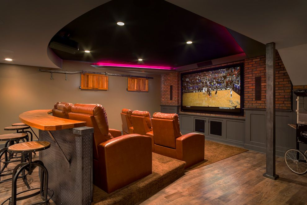 Hitching Post Theater with Traditional Home Theater  and Basement Theater Brick Walls Counter Stools Fiber Optic Ribbon Ceiling Lights Leather Chairs Lower Level Theatre Seating Urban Renewal Design Vinyl Plank Flooring Wood Counter