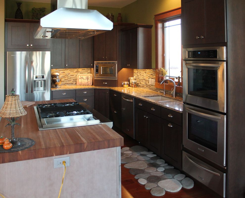 Intermountain Wood Products with Craftsman Kitchen  and Butcher Block Cambria Cherry Crown Molding Design Doors Drawers Gray Grey Hermans Islands Kitchen Cabinets Masterbrand Omega Cabinetry Quartz Wood Top