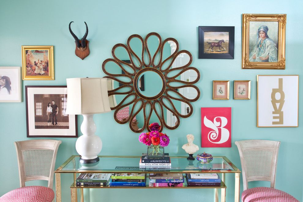 Key Largo Beaches with Eclectic Entry  and Antlers Artwork Caned Dining Chair Console Table Foyer Gallery Wall Glass Table Mirror Pink Cushions Sunburst Mirror Turquoise Turquoise Walls