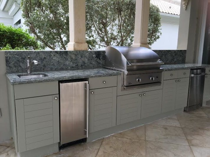 Key Largo Beaches with Traditional Patio  and Florida Kitchen Bath Remodel Florida Kitchens Florida Remodel Key Largo Beach Style Door Outdoor Cabinetry
