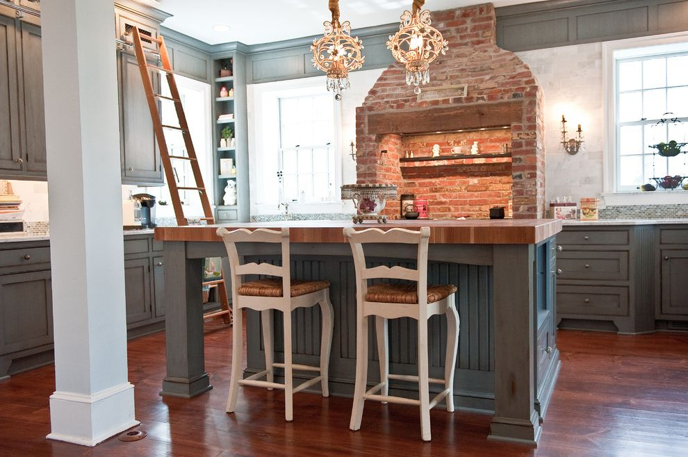 Lee Brick and Block   Traditional Kitchen Also Blue Cabinets Brick Butcher Block Chandelier Custom Cabinets Farmhouse Kitchen Island Kitchen Island with Butcher Block Ladder Library Stairs Marble Range Rustic Stove Wood Floor