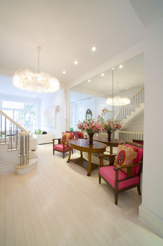 Mirror Mirror on the Wall Quote   Contemporary Entry Also Chandelier Crown Molding Mirrored Wall Obama Pillow Oval Console Table Pink Arm Chairs Staircase White Walls White Wood Floor
