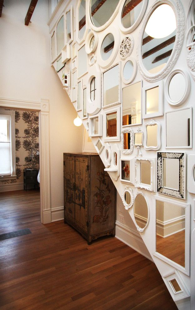 Mirror Mirror on the Wall Quote with Shabby Chic Style Hall Also Ornate Wood Armoire Rustic Wood Beams Slanted Wall Vertical Wall White Molding White Picture Frames White Trim White Wall Wood Beams Wood Floor