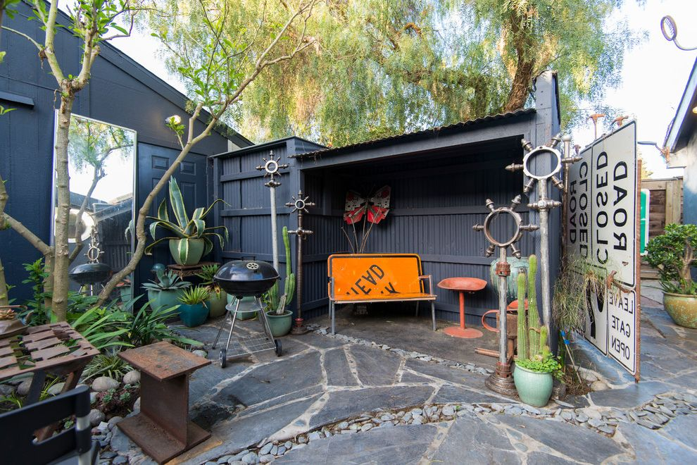 Moody Yard Sales   Eclectic Patio  and Bbq Charcoal Grill Dark Blue Siding Mirror Potted Cactus Potted Succulents Repurposed Traffic Signs