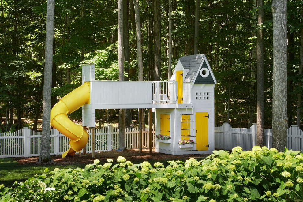 Outside Playsets   Traditional Landscape Also Backyard Bridge Hinges Kids Play Area Octagonal Window Play Playhouse Shingles Slide Swing Set Tube Slide White Picket Fence White Trim Window Box Woods Yellow Yellow Accents Yellow Door
