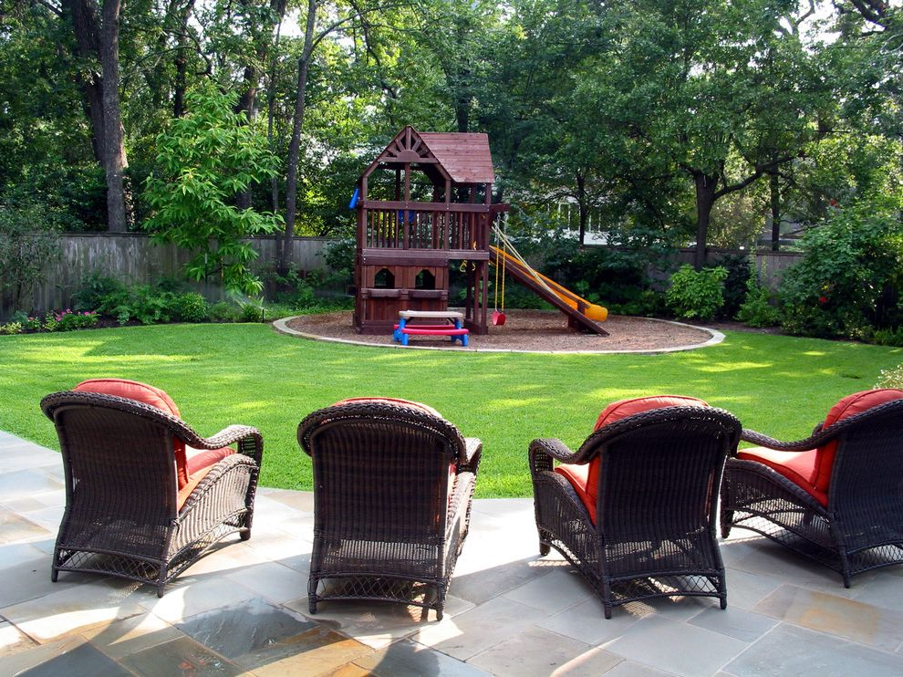 Outside Playsets   Traditional Landscape  and Fort Grandkids Grass Kids Backyard Kids Picnic Table Kids Playground Kids Playset Patio Pavers Play Set Red Cushions Slide Swing Wood Fence